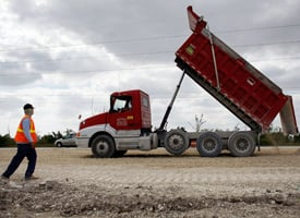 Road construction crews work on a widening project in Florida. (Joe Raedle/Getty Images)