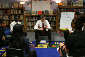 Education Secretary Arne Duncan speaks with a group of sixth graders at Paul Revere Elementary School on May 22, 2009, in San Francisco. Duncan toured the school during a visit in which he met with mayors and school district superintendents to discuss how the federal stimulus plan could affect schools. (Justin Sullivan/Getty Images)