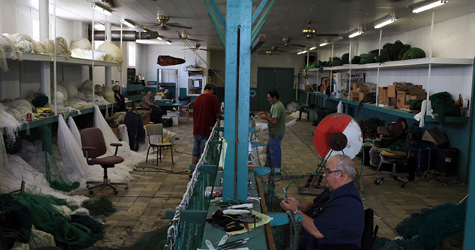 Workers make fishing net in Chine's Cajun Net Shop on June 16, 2010, in Galliano, La. Due to the bans on fishing in many areas of the Gulf, the store has experienced a drop-off in orders for new nets. (Spencer Platt/Getty Images)