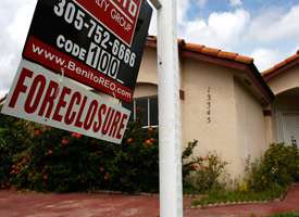 A foreclosure sign hangs outside of a Miami home. (Credit: Joe Raedle/Getty Images)