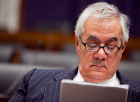 Rep. Barney Frank reads over a paper during a news conference on reducing military spending on Feb. 24, 2009 in Washington, D.C. (Brendan Hoffman/Getty Images)