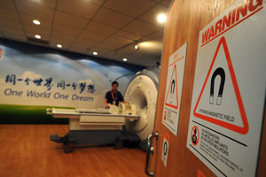 A product technician gives a demonstration inside the MRI room during a preview of the medical clinic for athletes competing at the 2008 in Beijing. (Frederic J. Brown/AFP/Getty Images)