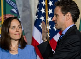 U.S. Treasury Secretary Timothy Geithner takes the oath of office alongside his wife, Carole, at the Treasury Department on Jan. 26, 2009. (Saul Loeb/AFP/Getty Images)