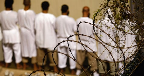 Detainees stand during an early morning Islamic prayer at the U.S. military prison for 'enemy combatants' on Oct. 28, 2009 in Guantanamo Bay, Cuba. (John Moore/Getty Images)