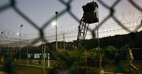 An American guard walks along the exterior of a camp for Chinese Uighur detainees at the U.S. military prison in Guantanamo Bay, Cuba. (John Moore/Getty Images)