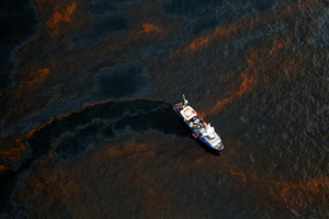 A boat makes its way through crude oil that has leaked from the Deepwater Horizon wellhead in the Gulf of Mexico on April 28, 2010, near New Orleans.  (Chris Graythen/Getty Images)