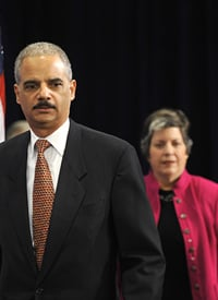 Eric Holder, President-elect Obama's nominee for attorney general, and Arizona Gov. Janet Napolitano, nominee for secretary of the Department of Homeland Security, arrive at a press conference on Dec. 1, 2008. (Jim Watson/AFP/Getty Images)