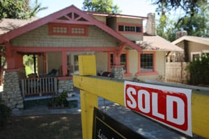 A 'sold' sign stands outside an existing home on September 24, 2009 in Pasadena, Calif. (David McNew/Getty Images)