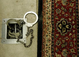 Handcuffs sit at the foot of a chair used for interrogation inside a cell in the maximum security Camp 5 at Camp Delta on May 9, 2006 in Guantanamo Bay, Cuba. (Mark Wilson/Getty Images)