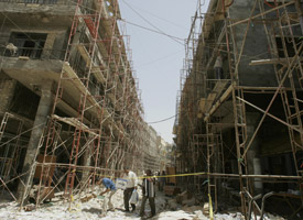Scaffolding covers buildings in central Baghdad in May 2008. (Credit: Sabah Arar/AFP/Getty Images)