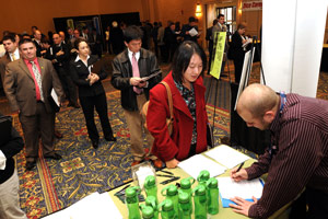 Job hunters at a career fair in Burlington, Mass., in December 2008. The number of people getting jobless benefits spiked early the next year, depleting the state's unemployment insurance fund.  (Darren McCollester/Getty Images)