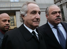 Bernard Madoff, center, walks out from Federal Court after a bail hearing in Manhattan on Jan. 5, 2009. (Hiroko Masuike/Getty Images)