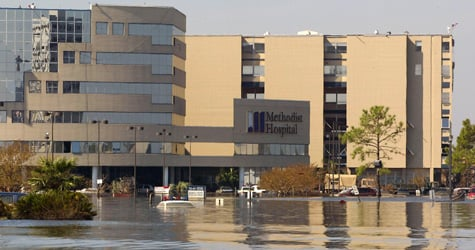Pendleton Memorial Methodist Hospital stands partially submerged in flood waters on Sept. 8, 2005, in east New Orleans, La., in the aftermath of Hurricane Katrina. (James Nielsen/AFP/Getty Images)