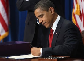 President Barack Obama signs the economic stimulus bill on Feb. 17, 2009 in Denver, Colo. (John Moore/Getty Images)