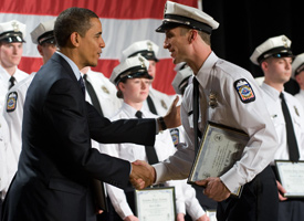 President Obama shakes hands with a newly-sworn in Columbus Police Department officer during graduation ceremonies in Columbus, Ohio, on March 6, 2009. (Saul Loeb/AFP/Getty Images)