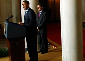 President Barack Obama delivers remarks about executive compensation with Treasury Secretary Timothy Geithner in the Grand Foyer of the White House on Feb. 4, 2009. (Win McNamee/Getty Images)