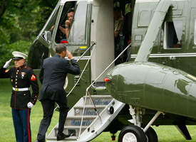 President Barack Obama salutes as he walks on the steps of the Marine One on the South Lawn prior to his departure from the White House for Nevada. (Alex Wong/Getty Images)