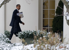 President Barack Obama walks to the Oval Office after returning from the Capitol. (Saul Loeb/AFP/Getty Images)