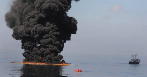 Oil burns during a controlled fire May 6, 2010, in the Gulf of Mexico. (Justin E. Stumberg/U.S. Navy via Getty Images)