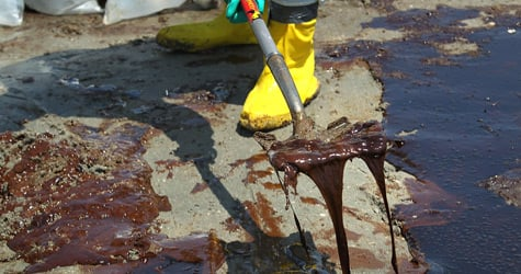 A BP cleanup crew shovels oil from a beach on May 24, 2010, at Port Fourchon, La. (John Moore/Getty Images)