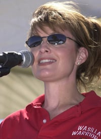Sarah Palin speaks before a Wasilla crowd in 2002. (Credit: Robert A. Baker/Getty Images)