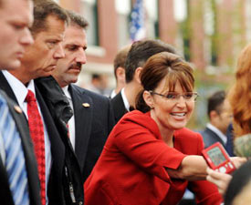 Secret Service agents keep an eye on the crowd as they provide protection for Governor Sarah Palin at a campaign event in Lebanon, Ohio on September 9, 2008.   (ROBYN BECK/AFP/Getty Images)