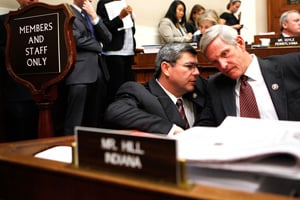 Rep. Mike Ross, left, talks to Rep. Baron Hill, D-Ind., right, during a mark up hearing on the health care bill before the House Energy and Commerce Committee on July 30, 2009  (Alex Wong/Getty Images)