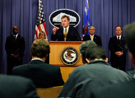 Acting U.S. Assistant Attorney General Matthew Friedrich, center, announces that German company Siemens AG has pleaded guilty to Foreign Corrupt Practices Act violations during a news conference. (Chip Somodevilla/Getty Images)
