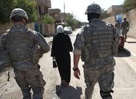 U.S. soldiers patrol the Doura neighborhood in Baghdad, Iraq. (Credit: Spencer Platt/Getty Images)