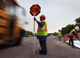 A road construction flagger slows traffic next to a road project funded by federal stimulus funds on May 21, 2009 in Littleton, Colo. (John Moore/Getty Images)