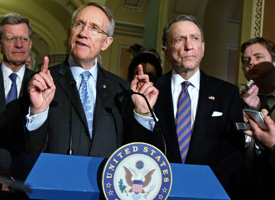 Senate Majority Leader Harry Reid (D-NV), Sen. Max Baucus (D-MT) and Sen. Arlen Specter (R-PA) participate in a news conference to announce the Senate and House have reached a deal on a $789 billion economic rescue plan on Feb. 11, 2009. (Chip Somodevilla/Getty Images)