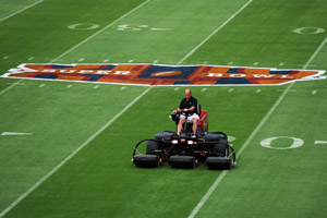 A grounds crew worker prepares the field on Feb. 2, 2010, in Miami Gardens, Fla.  (Michael Heiman/Getty Images)