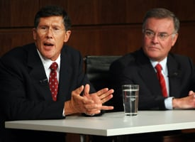 Former Merrill Lynch CEO John Thain, left, and Bank of America CEO Ken Lewis speak at a press conference announcing Bank of America's $50 billion takeover of Merrill Lynch. (Mario Tama/Getty Images)