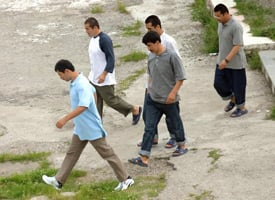 Five Chinese Uighur Muslims in the Albanian National Center for Refugees in May 2006 (Gent Shkullaku/AFP/Getty Images)