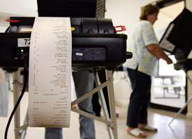 Voters use touch-screen machines in Florida for the 2004 election. (Credit: Mario Tama/Getty Images)