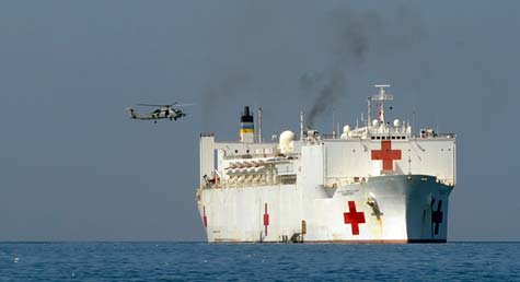 A helicopter lands on the USNS Comfort hospital ship off of Port-au-Prince, Haiti, on Jan. 23, 2010. (Thony Belizaire/AFP/Getty Images)