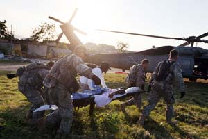 U.S. soldiers carry an injured woman to a Navy helicopter bound for the USNS Comfort on Jan. 23, 2010 in Port-au-Prince, Haiti. (Joe Raedle/Getty Images)