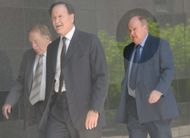 Albert Jack Stanley, right, and his lawyers walk into the federal courthouse in Houston, Texas. (Credit: PBS's Frontline)