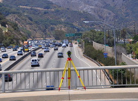 A surveying tripod on the Sunset Boulevard overpass above Interstate 405 in West Los Angeles on July 14, 2009. (Clear365/Paul Chavez)