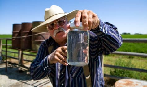 Louis Meeks' well water contains methane gas, hydrocarbons, lead and copper, according to the EPA's test results. When he drilled a new water well, it also showed contaminants. The drilling company Encana is supplying Meeks with drinking water.  (Abrahm Lustgarten/ProPublica)