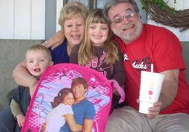 The Moffits with their grandchildren.