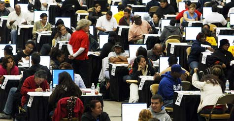 Financial counselors at an Oct. 2009 event assisting homeowners with restructuring their mortgages. (Justin Sullivan/Getty Images/Daly City, Calif.)