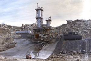 This 1963 image depicts an overall view of the vertical test stand for testing the J-2 engine at Rocketdyne's Propulsion Field Laboratory, in the Santa Susana Mountains, near Canoga Park, Calif. Boeing, which was fined for dumping a toxic stew of pollutants at this site, has won a no-bid stimulus contract to clean it up. (NASA)