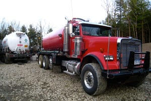 Trucks like this one, owned by Barber & Deline, carry gas wastewater across the state to sewage plants and other water disposal facilities. (Joaquin Sapien/ProPublica)