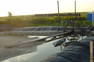 This photo, taken Oct. 5, 2007, is of the underground injection disposal well site outside Fort Worth, Texas, that had passed the Railroad Commission's inspection on Sept. 27, 2007. On their second visit two months later, inspectors found several violations, including dikes that did not meet the facility's holding capacity. (Photo courtesy of Sharon Wilson)