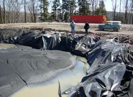 An open well pit in Susquehanna County, Pa., holds the sediment from a freshly-drilled well. (Credit: Edward Marritz)