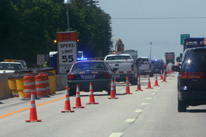 Traffic moves around road construction work on Interstate 93 in Hookset, N.H., in June. (Jim Cole/AP Photo)