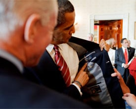 President Barack Obama met with labor leaders in the Blue Room in April and showed that his suit was made in the U.S.A. (White House photo by Pete Souza)