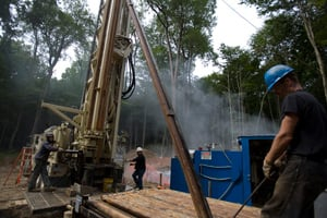 A drilling crew move a section of steel pipe at a natural gas well site near Bradford, Pa., last August. (Robert Nickelsberg/Getty Images)