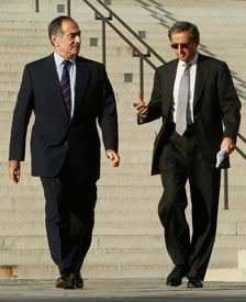 Morgan Stanley CEO John Mack (L) walks with Citigroup CEO Vikram Pandit (R) as they leave a meeting at the Treasury Department . (Mark Wilson/Getty Images)